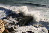 Sea wave breaks on a rock. — Stock Photo