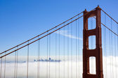 Bridge to the city in the clouds — Stock Photo