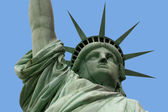 Statue of liberty and arm — Stock Photo
