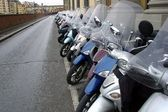 Big row of motorcycles on the street — Stock Photo
