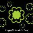 Royalty-Free Stock Vector Image: Black background with shamrock blossom