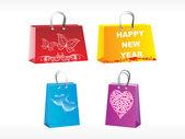 Cuatro diferentes bolsas de diseñador — Vector de stock