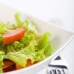 Fresh salad and fork — Stock Photo
