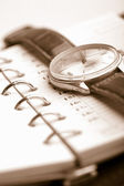 Personal organizer and watch — Stock Photo