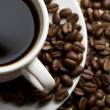 Cup of coffee and coffee beans — Stock Photo #1701061