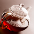 Glass teapot with black tea — Stock Photo