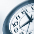 Blue clock shaking. time consept — Stock Photo