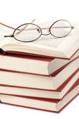 Pile of books with glasses isolated — Stock Photo