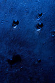 Dark blue water drops background — Stock Photo