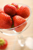 Ripe strawberries in glass bowl — Stock Photo