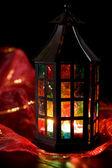 Coloful lantern burning in the dark — Stock Photo