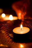 Holiday candles burning in the dark — Stock Photo