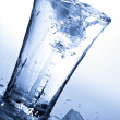 Water splashing into glass with — Stock Photo