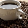 Cup of coffee and coffee beans — Stock Photo #1753626
