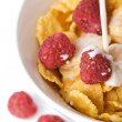 Royalty-Free Stock Photo: Milk pouring into muesli and raspberry