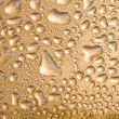 Golden water drops over metal — Stock Photo #1753725