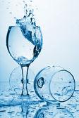 Pure water splashing into glass — Stock Photo