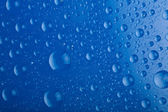 Blue water droplets background — Stock Photo