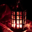 Red lantern burning in the dark - Stock Photo