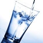 Water splashing into glass — Stock Photo