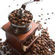 Coffee grinder and roasted coffee — Stock Photo