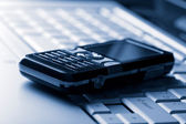Keyboard and mobile phone background — Stock Photo
