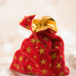 Red christmas sack full of presents — Stock Photo