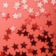 Holiday red background with stars — Stock Photo
