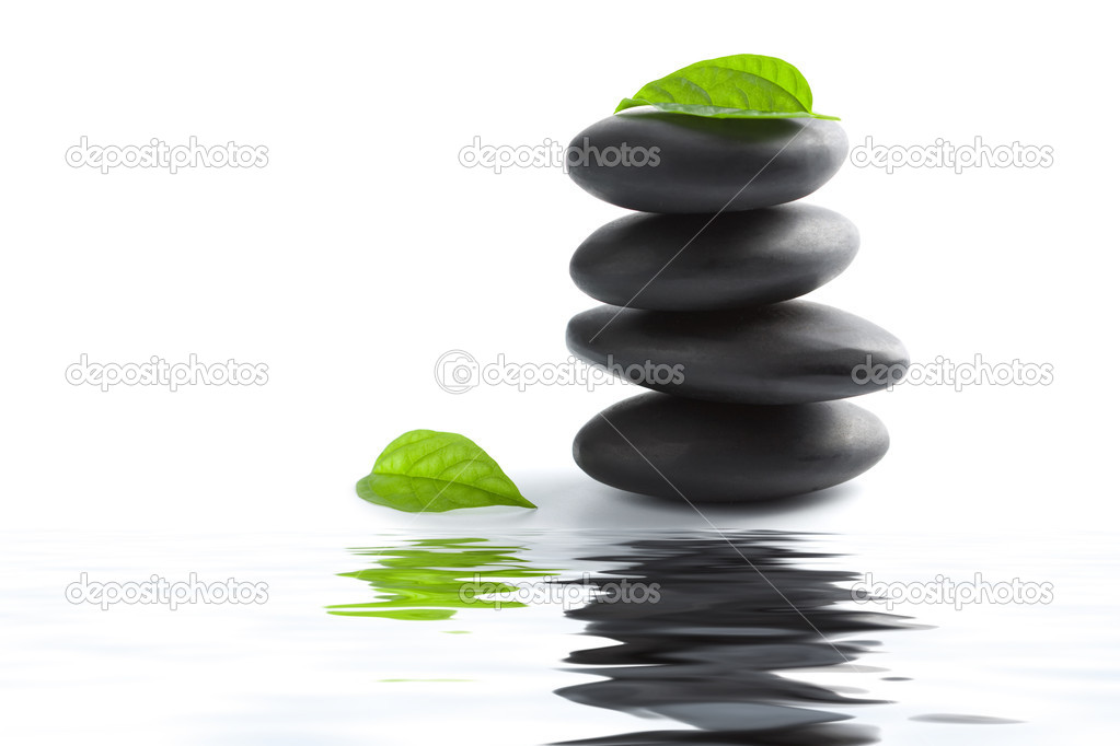 Zen stones and leaves reflecting in water isolated — Stock Photo #1787903