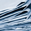 Stock Photo: Stack of newspapers toned blue