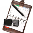 Organizer and mobile phone isolated — Stock Photo