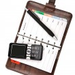 Organizer and mobile phone isolated - Stock Photo