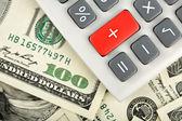 Dollars and calculator — Stock Photo