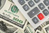 Calculator over dollars — Stock Photo