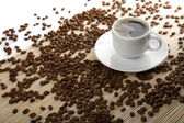 Cup of coffee and coffee beans isolated — Stock Photo