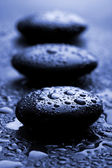 Shiny zen stones with water drops — Stock Photo