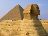 Sphinx and pyramids in Giza — Stok fotoğraf
