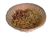 Wattled basket with nuts — Stock Photo