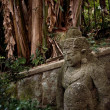 Ancient statue in the forest - Stok fotoğraf