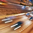 coches rápidos moviéndose en la noche — Foto de Stock