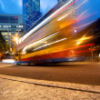 Foto Stock: Fast moving bus at night