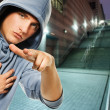 Young handsome men in a hood outdoors — Stock Photo #1420771