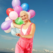 Happy girl with balloons — Stock Photo #1420924