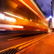 Fast moving bus at night — Stock fotografie