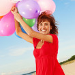 Happy girl with colorful balloons — Stock Photo #1421023