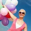 Young woman with colorful balloons — Stock Photo