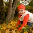 Stock Photo: Beautiful little girl with autumn leaves