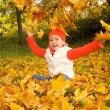 Beautiful little girl with autumn leaves — Stock Photo