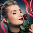 Charming lady with red rose — Stock Photo