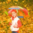 Beautiful little girl with umbrella — Stock Photo